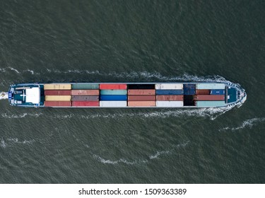 A Small Cargo Ship Carrying Containers Bird's Eye View
