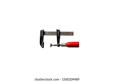 A small carpentry clamp with a red, wooden handle, isolated on a white background with a clipping path.