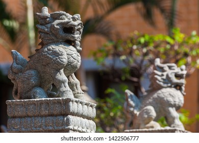 Small carved stone lion statue in Chinese temple