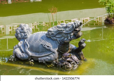 Small carved turtle stone statue fountain in Chinese temple