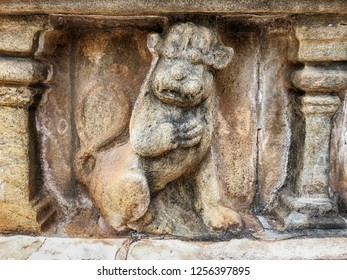 A small carving of a lion is carved into a stone frieze along the outside edge of the Vatadage dagoba shrine in the ancient city of Polonnaruwa in Sri Lanka.