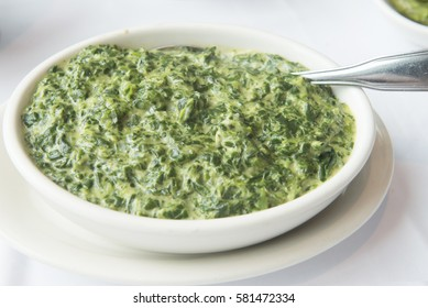 A small casserole dish of spinach in cream sauce