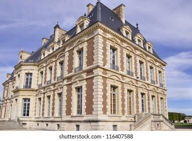 Small castle, colors of Autumn, in Sceaux near Paris, France