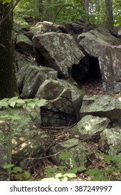 Small cave in a jumble of granite at Connors Farm in Smithfield, RI, USA