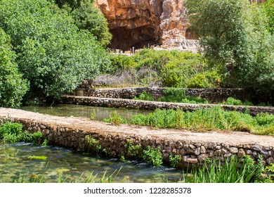 The small cave and part of the ancient Banias water gardens and pathways at the bottom of Mount Hermon in the North Golan Heights Israel