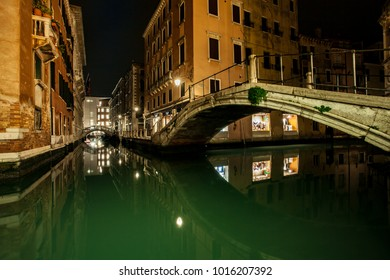 small channel and Bridges in lagoon city venice at night. long exposure Venezia Italy