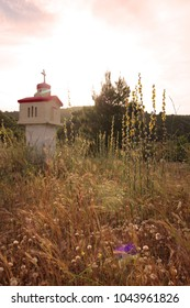 Small chapel by the road in Greece, sunset