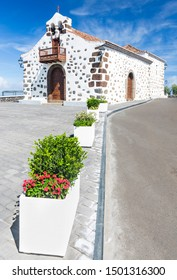 The small chapel Ermita de San Bartolome in the east of La Palma, Spain with some flower pots leading to it.