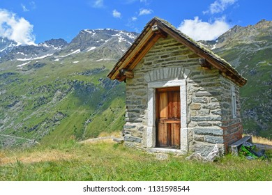 Small chapel in the mountains on a clear, sunny summer day