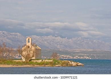 Small chapel on the shores of Novigradsko more also Novigrad sea called a bay northeast of Zadar on the upper Adriatic