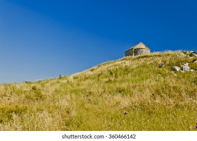 small chapel of st. georg situated on perun hill east from city of split, croatia, europe