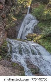 A small charming waterfall along Torrente Avisio (Avisio stream), nearby Cavalesse commune & Castello di Fiemme village in Fiemme valley, Predazzo commune, Trentino, Alto-Adige, Dolomites, Italy