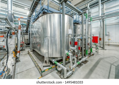 Small chemical plant. Production of chemical emulsions for mining. A lot of clean and shiny pipelines, taps, valves.