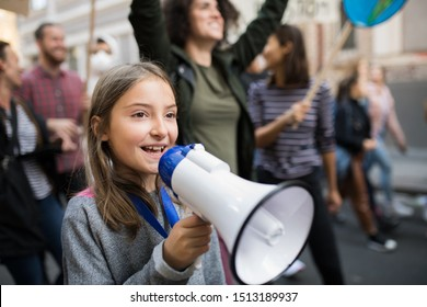 Small child with amplifier on global strike for climate change.