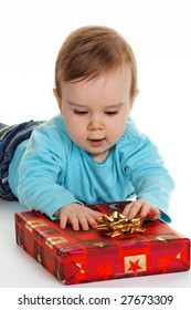 Small child with a baby gift package for Christmas
