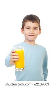 Small child boy offering a glass with fresh orange juice and smiling isolated on white background