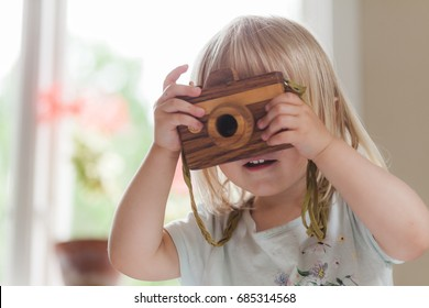 Small child with camera taking pictures