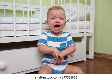 a small child crying near his bed
