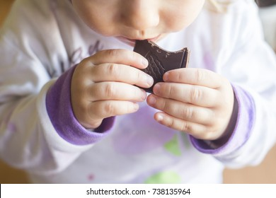 small child is eating chocolate