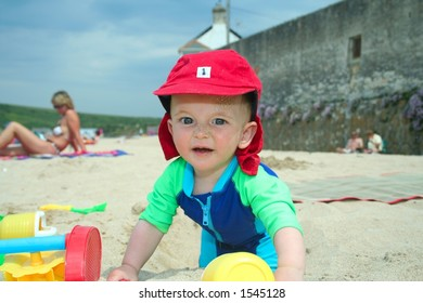 Small child exploring a beach in Cornwall.