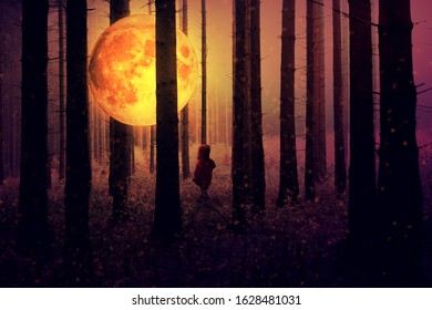 A small child with mystic moon in the forest. Spooky atmosphere and dark light