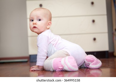 small child on the floor, who was crying, but does not scream. A tear rolling down his cheek. Blurred background. Photo girl.