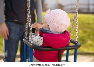 Small child on a swing on the playground