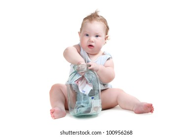 small child playing with a glass jar with the money