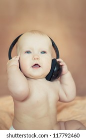 a small child playing with headphones