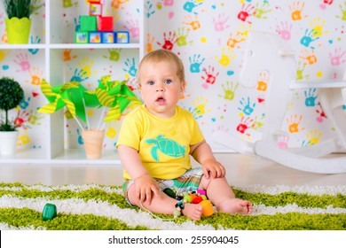 a small child playing in a light room