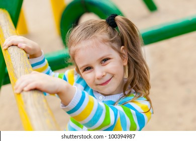 Small child playing on colorful playground