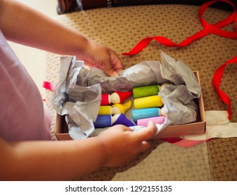 a small child plays with colored natural wooden dwarfs . Waldorf. natural toys. life style photo