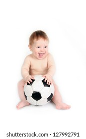 The small child plays with a soccerball