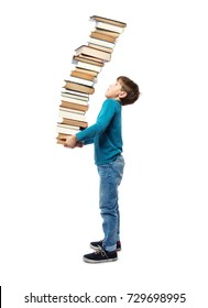 Small Child in Primary School age carrying a very high stack of books. Concept for a heavy workload of Homework assignments