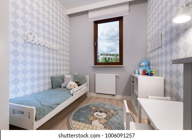 Small child room in pastel blue color