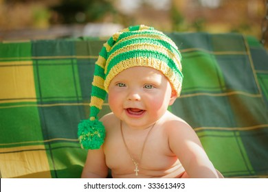 a small child sits in the hat