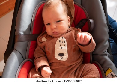 small child sitting in a child car seat