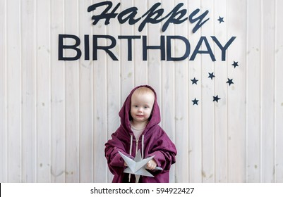 Small child standing in sports suit big size. Birthday of the kid