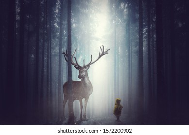 A small child stands in front of a large deer in the dark fog forest