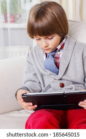A small child with a touchscreen tablet