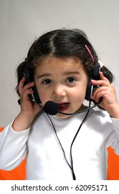 small child wearing a head to headset