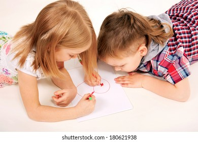 Small children, boy and girl drawing heart. Love and valentine's day concept.
