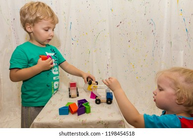 small children play educational game