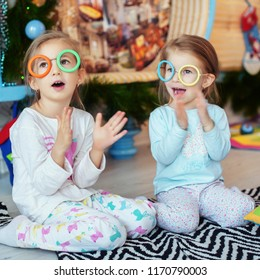 Small children of preschool age. They sing and play. Square. The concept of Christmas and New Year