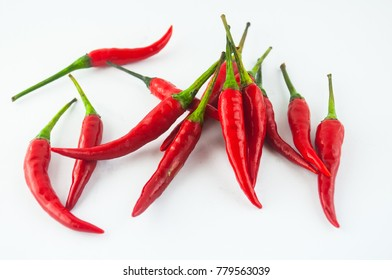 Small chilli pepper close up isolated on white. Food ingredients. Fresh vegetables