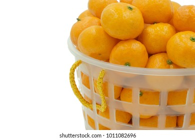 Small Chinese tangerines in a basket