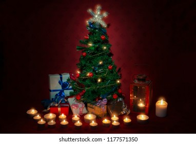 Small Christmas tree with gifts and many candles