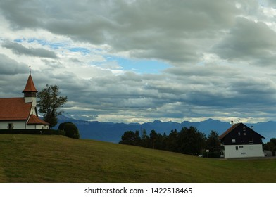 Small Church and a cloudy mountain in Epalinges Lausanne Switzerland