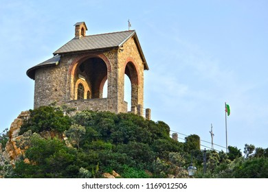 small church located on a hill at the entrance to the port of Alassio, Liguria, Italy