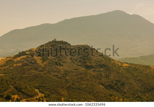 A small church on top of a mountain in Greece  in the Zagoria region. National park of Pindus mountain